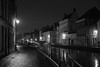 canal along Verversdijk and Sint-Annarei, Bruges, Belgium (Plan R) Tags: street pavement cobblestone rain evening monochrome blackandwhite leica m 240 noctilux 50mm bruges canal building