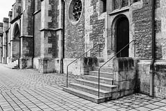 Play in Grey (Thomas Listl) Tags: thomaslistl blackandwhite noiretblanc biancoenegro facade architecture church grombühl würzburg grey tones analog filmphotography minolta minoltax700 kodak tmax tmax400 push pushto800 push1stop stone stairs 35mm