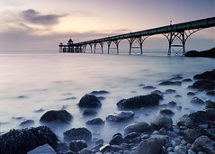Watching the day end (fyule903) Tags: clevedon clevedonpier pier somerset england water sea longexposure sunset seascape rocks dreamy tranquil ethereal peaceful evening bronica bronicaetrsi etrsi