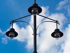 Symmetric street lamps (Ciddi Biri) Tags: bluesky citynight citystreet cloudysky electric electricity energysave lamp ledstreetlight light nightlamps street summer threelamps triangle symmetry symmetrical symmetric triple m43turkiye sky