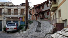 a street in Arachova IMG_9760 (mygreecetravelblog) Tags: greece centralgreece arachova boeotia viotia town mountaintown alpinetown outdoor landscape buildings architecture street road