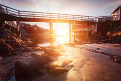 A, le ponton. Under the bridge / A, Norway (jonathan le borgne) Tags: a lofoten norway norvège light sun sunrise ray colors red orange pink yellow morning woodhouse house sea water seascape landscape beach sky clouds winter bridge pont hiver ciel nuages rocks shadow contrast canon canon6d canon1635f28liiusm