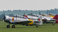 Harvard Line Up (davepickettphotographer) Tags: iwm duxford theimperialwarmuseumuk imperialwarmuseum warmuseum airshow may airfestival cambridgeshire cambridge england northamerican havard trainer aircraft vintage aviation aeroplane