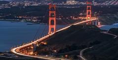 Golden Gate trails (reinaroundtheglobe) Tags: goldengatebridge longexposure traffic rushhour lighttrails highway mountains ocean bridge sanfrancisco california usa