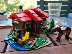 I had a productive day (Ruth and Dave) Tags: fisherman legoperson figure lego man building cabin fishing logcabin moose