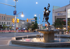 Guelph Ontario (waterfallout) Tags: guelph guelphontario guelphcanada guelphontariocanada downtownguelphontario downtownguelph guelphatdusk guelphatnight thefamilysculpture stgeorgessquare sculpture fountain dusk night