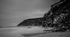 Rugged and smooth (NikNak Allen) Tags: mawganporth cornwall beach sand coast bay ocean sea water cliff cliffs rocks stones sky longexposure grey black white blackandwhite seascape landscape morning early low light shadow