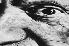I see you (Thad Zajdowicz) Tags: zajdowicz pasadena california usa travel canon eos 5d3 5dmarkiii dslr digital availablelight lightroom outside outdoors chalkfestival carshow ef24105mmf4lisusm street urban city blackandwhite art detail face nose eye black white bw monochrome sidewalk closeup