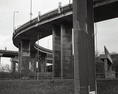 Spaghetti Junction (OhDark30) Tags: carl zeiss jena czj werra 3 tessar 2850 35mm film monochrome bw blackandwhite bwfp ilford fp4 200 rodinal spaghetti junction m6 birmingham flyover motorway road bridges curves concrete weathering