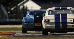 Two antiques - explored 4-12-2018 (speedcenter2001) Tags: vintageracing vintage race racecar racetrack racing roadamerica roadcourse roadracing elkhartlake wisconsin motorsports motorsport rennsport classic historic svra hurrydowns 400mmf28gvr nikon400mmf28gvr d500 teleconverter tc14eii rear curb corvette mustang muscle car colorgraded