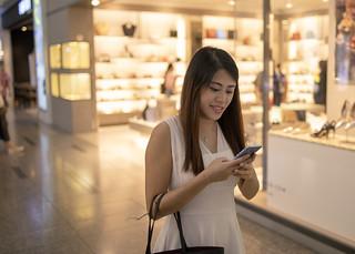 Singapore woman walking in shopping mall