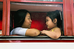 Bus Ride (Artypixall) Tags: philippines manila mother daughter younggirl riding bus portrait street scene faa getty