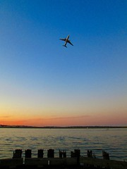 Departure (Cutting Monkey) Tags: sky sea ocean bostonharbor sunset dusk water reflection airplane