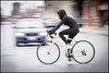 Hooded Cyclist (Dan Dewan) Tags: 2018 canonef70200mmf14lisusm dandewan bicycle bankstreet street people person canon colour cyclist ottawa march motion woman ontario canada panning spring thursday portrait