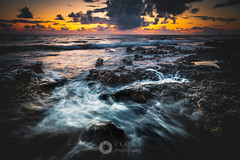 Dusk along the Shore (RTA Photography) Tags: cyprus paphos sea light clouds seascape nikond750 nikon fullframe fx rocks wave glow sunset longexposure 2stopgnd outdoors weather nature colours colour detail seascapes