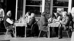 enjoying the spring sunshine 03 (byronv2) Tags: grassmarket sunny sunshine spring oldtown edinburgh edimbourg scotland blackandwhite blackwhite bw monochrome peoplewatching candid street restaurant dining eating table chair seat seated food