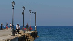 tourists on the Chania harbourside walkway IMG_0235 (mygreecetravelblog) Tags: walkway greece crete greekisland greekislands island chania hania xania city town harbour seaside coast seafront water sea sky landscape outdoor