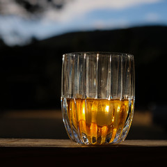 Evening Scotch … (Thru Mikes Viewfinder) Tags: scotch whiskey glass evening sky clouds mountains golden glow sunset