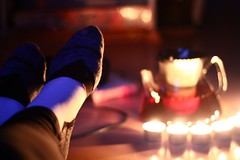 Oh yeah, I am a true hero (Nathalie_Désirée) Tags: hedonism socks runningsocks teapot glass tea red evening candle candlelight candles enjoy book bokeh flair atmosphere ambience feet