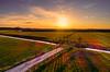 Sunset over the Westfriese Dijk. (Alex-de-Haas) Tags: oogvoornoordholland thuystenuwendore 24mm ci dji dutch eenigenburg fc6310 hdr holland huistenuwendoorn krabbendam nederland nederlands netherlands noordholland phantom phantom4 phantom4pro aerial aerialphotography cirrus cloud clouds drone goldenhour landscape landschap lucht meadows polder skies sky sundown sunset weilanden winter wolk wolken zonsondergang
