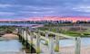 Mudeford Spit Sunrise (nicklucas2) Tags: beachhut harbour christchurch sea sand pebble sunrise cloud bridge