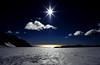 Tasman Sea with Glacier  (Film) (Harald Philipp) Tags: glacier foxglacier newzealand tasmansea rainforest velvia100 velvia pentax 645 645n 645nii smc prime primelens ice snow helicopter clouds bluesky contrast golden mountain