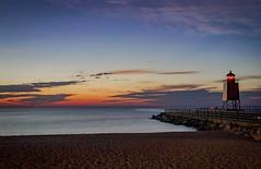 Sundown on Lake Michigan (T P Mann Photography) Tags: longexposure sand beach shore pier seascape sea lake lakemichigan lighthouse light clouds sky color twilight night evening dusk sunlit sundown sunset michigan charlevoix