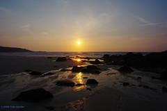 3KB04265a_C (Kernowfile) Tags: cornwall stives porthmeorbeach sunset sea water reflections pentax