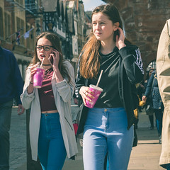 Chester Girls (Howie Mudge LRPS BPE1*) Tags: girls females women people busy highstreet towncenter bright sunny day outside outdoors travel light shadows shade chester england uk cheshire drink straw squareformat candid casual portrait street streetphotography streetlife streetstyle microfourthirds orangeandteal panasonicdmcg80 lumixgvario1260f3556