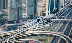 Toy Town.... (Aleem Yousaf) Tags: toy town miniature city dubai vantage point highway metro track sheikh zayed road traffic card skyscraper spaghetti junction flyover tilt shift style texture digital asia east middle uae morning architecture modern nikkor united arab emirates lines cityscape colour colorful candid shadows light desert photo photography real estate outside outdoor world gulf camera downtown steel towers