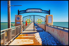 The Port Stanley Pier (Ontario, Canada) (Kᵉⁿ Lᵃⁿᵉ) Tags: can canada geo:lat=4265683087 geo:lon=8121499972 geotagged grimmondsbeach ontario portstanley 28300 28300mm art color colorful digitalart gate horizon lake lakeerie landmark lightpole municipality nikkor nikkor28300 nikon nikond800 oilpaint oilpainting ontariocanada painting photoshop photoshopoilpaint pier piergate portstanleyontario portstanleyontariocanada portstanleypier sign signage sky snow theportstanleypier tourism touristattraction travelblog traveldestination travelphotography water