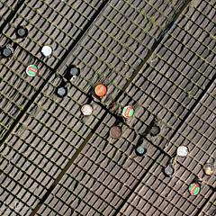 bottle tops | groundworks | dublin [explored] (John FotoHouse) Tags: dolan dublin flickr fujifilmx100s fuji johnfotohouse johndolan leedsflickrgroup copyrightjdolan ireland groundworks downisthenewup square squareformat minimal explore