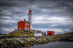 Fisgard Lighthouse (Paul Rioux) Tags: fisgard lighthouse fortroddhill historic sight old architecture preserved restored waterfront seaside clouds ocean sea water red weather rocks colwood bc prioux