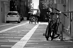 A peaceful ride (jimiliop) Tags: bicycles cycling street bw blackandwhite man joy nafplio lines vanishingpoint ride quiet alley monochrome tourist