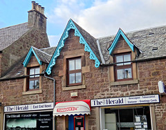 A Broader View (Colorado Sands) Tags: building architecture scotland signs sandraleidholdt uk unitedkingdom gb greatbritain shop shopping window sign theherald tunnocks exteriortrim chimney stone mainstreet callander