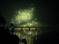 Fireworks on the Day of the Sun, North Korea (TeunJanssen) Tags: northkorea fireworks bridge river korea dprk ypt youngpioneertours travel night kimilsung anniversary pyongyang asia traveling worldtravel backpacking olympus omd omdem10 juchetower