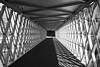 Tunnel vision (The Green Album) Tags: public bridge walkway tunnel shapes pattern shadows southampton carpark shops monochrome light westquay