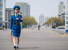 The traffic ladies of Pyongyang (TeunJanssen) Tags: pyongyang northkorea korea dprk traffic trafficladie ladie security officer travel worldtravel ypt youngpioneertours traveling backpacking street dof 75mm olympus omd omdem10