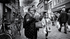 Girls Will Be Girls (Alfred Grupstra) Tags: people street blackandwhite urbanscene citylife men city crowd outdoors women cultures walking traveldestinations groupofpeople citystreet editorial travel tourist europe