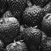 Black and white macro of yummy strawberries background