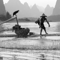 Cast Net - Touchdown (lc99photography) Tags: cast castnet fisherman cormorantfisherman cormorantfishing reflections karst karstformation monochrome blackandwhite water lijiang liriver oldman guilin guangxi china travel splash birds raft bambooraft circle pattern
