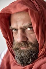 Lifes illusions (MayaAlameddine) Tags: man beard veil portrait color portraiture eyes look light life friend stevemccurry