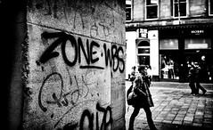 Zone Focusing. (Mister G.C.) Tags: street urban photography blackandwhite bw olympus xa2 olympusxa2 dzuiko zuikolens f35 35mm primelens fullframe compactcamera compact camera zone focus zonefocusing lomographycolour400 streetphotography urbanphotography shot image photograph candid people graffiti vandalism wall gritty monochrome town city analog analogphotography analogue film filmcamera schwarzweiss strassenfotografie mistergc glasgow scotland europe