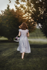 (Rebecca812) Tags: girl basket flowers lilacs spring outdoors rearview curlyhair wavyhair timeless grass sunlight evening gathering beauty nature dress flowy romantic canon portrait people rebeccanelson rebecca812
