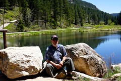 Ali relaxes by a fishing pond in Spearfish Creek (ali eminov) Tags: forest nationalforest blackhillsnationalforest highways spearfishcanyonscenichighway southdakota creeks spearfishcreek ali