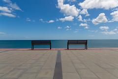 empty (Rasande Tyskar) Tags: kanarischeinseln kanaren canaryislands islascanarias canarias minimalism minimalismus simple lines horizon benches bänke empty bank bench linie sky clouds himmel wolken