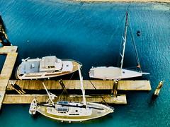 P4213067 (kogo_007) Tags: powerboat sailboat blue lightblue sailing pleasurecraft docks waterfront adventure woodenslats woodtexture textureonwater shoreline