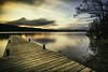 Windemere Jetty (jaygilmour11) Tags: windemere lakedistrict nikon lake sunset sun trees clouds longexposure jetty wood leefilters mountains cumbria stones rocks water slowshutter blue orange red beauty calm serene