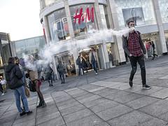 Human Contrail (Wormsmeat) Tags: hm vaping vapour vapor contrail shoppingcentre shoppingmall check intrusion smoker smoking smoke brighton pavement dutchtilt panasonic dmcgm5 leicadgsummilux15mmf17