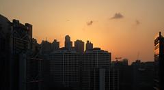"""dusk"" (hugo poon - one day in my life) Tags: xt20 35mm hongkong central hsbcmainbuilding landmark plane office skyline sky skyscrapers city urban dusk colours architecture sunset"